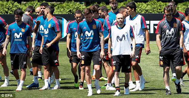 Lopetegui, pictured (right) with his squad on Tuesday, angered the Spanish FA top brass