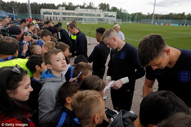The England stars signs autographs for the school children following the training session