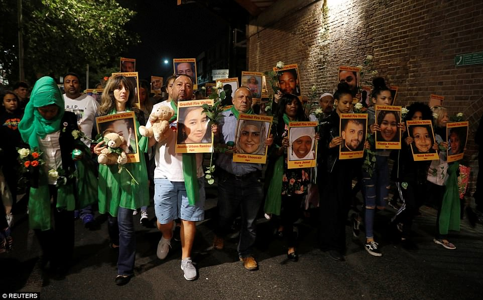 Bereaved family members of those who died in the diaster wore green and held pictures of their loved ones as they marched towards the tower