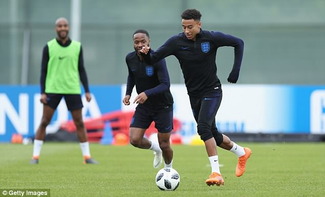 The United boss has seen four of his Reds picked for the side, including Jesse Lingard (right)