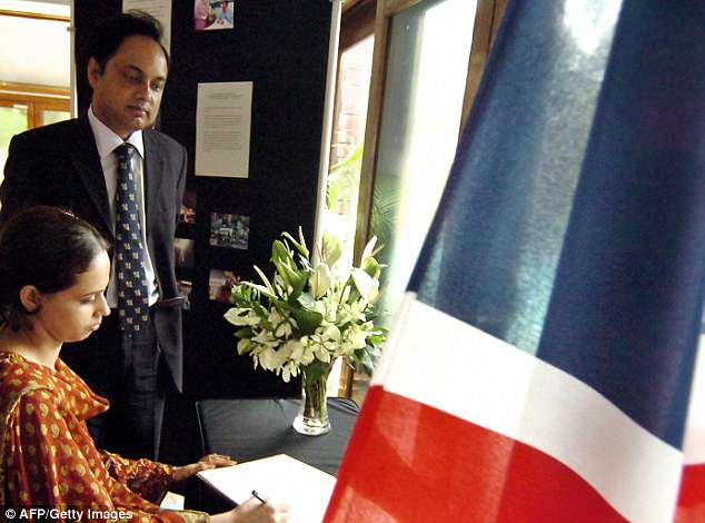 Choudhury is pictured with a Bangladeshi woman signing a book of condolence following the July 7 bombings in London in 2005
