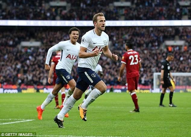 Harry Kane celebrates scoring a goal during a clash with Liverpool at Wembley last season - the Reds will be Tottenham's first opponents at their new White Hart Lane stadium