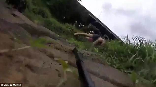 The selfie stick the young man had been holding lies at the bottom of the slope, capturing his astonishingly energetic recovery