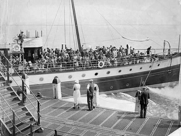 A boat load of holiday makers arrive at Hastings Pier in this undated photograph