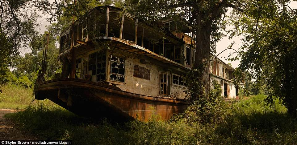 Eerie images have revealed the abandoned remains of an historic towboat that once served as President Roosevelt's Mississippi River headquarters in the 1940s,abandoned at Deer Park, Louisiana, 10 miles from the Mississippi