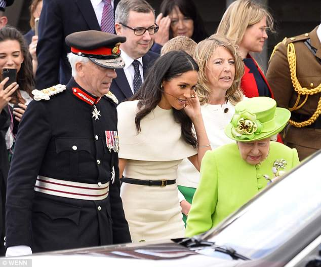 Confusion: It appears Meghan was told to let the Queen get into the car first, but after the Queen went in ahead she later stepped in and suggested she get in first