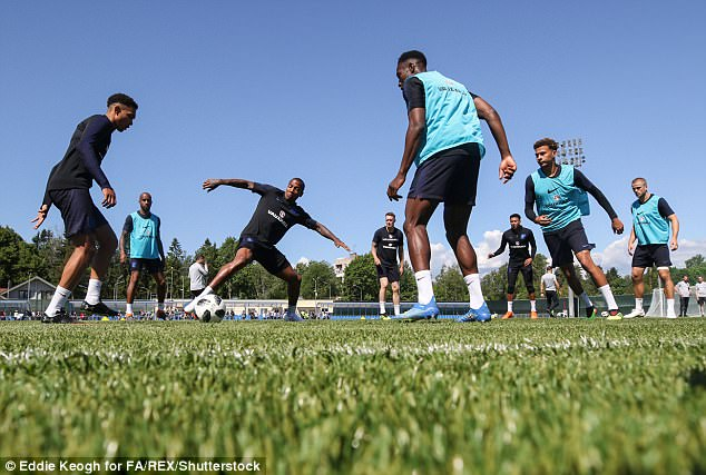 Ashley Young stretches for the ball with Alexander-Arnold lurking behind him
