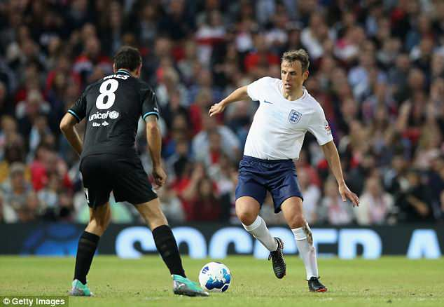 Neville, playing here for England at Soccer Aid, hopes the current squad avoid a similar fate