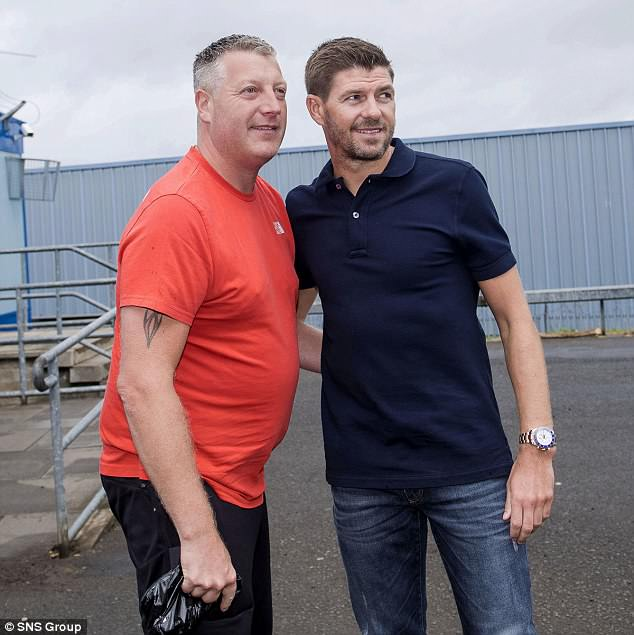 Gerrard took time to pose with a fan for a photograph as he arrived for training