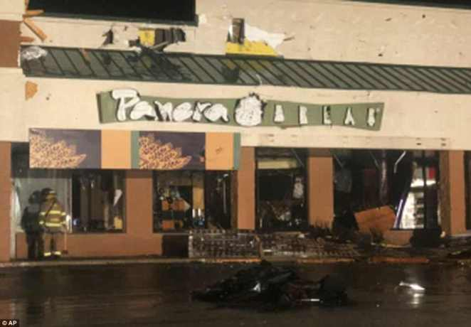 A Panera Bread at the mall suffered extensive damage in the tornado where its sign was ripped off and front windows broken