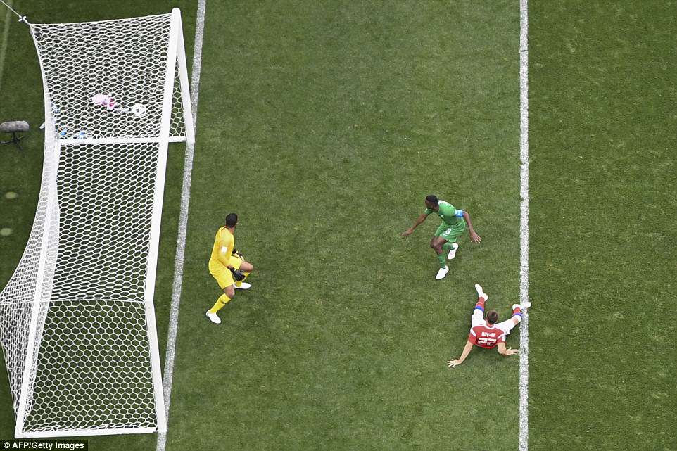 The 29-year-old watches on as his header back across goal flies into the bottom far corner ofAlmuaiouf's net