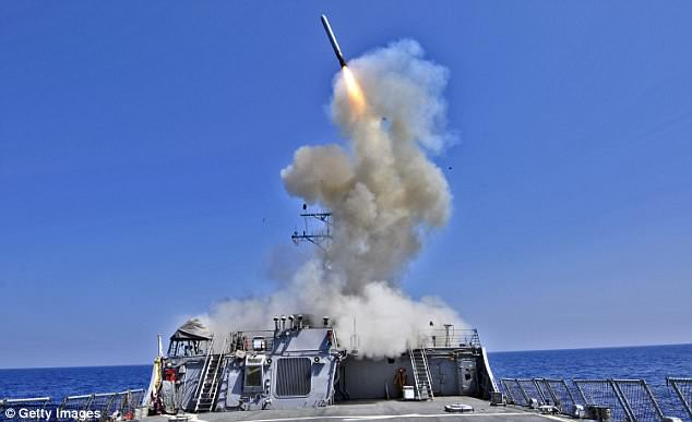 The DoD is working with Hyperion Technology Group to develop a prototype, which would fit inside an existing warhead casing. Pictured, the U.S. Navy guided-missile destroyer USS Barry (DDG 52) launches a Tomahawk cruise missile