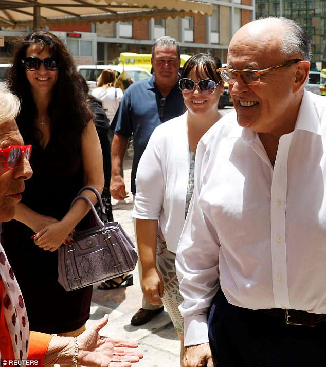Rudy Giuliani boasted to friends that he was dating a big-breasted woman before it was claimed on Tuesday that he was having an affair with Dr. Maria Rose Ryan who accompanied him to Israel last week with her daughter Vanessa (in white). She is pictured in black standing behind him on June 7. During one hospital tour, she was introduced as his partner. He has denied being involved with Ryan