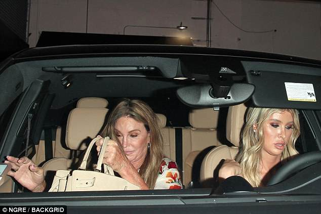 Driver: Sophia seemed to be driving the couple to and from dinner wearing a strapless top, with her long blonde hair covering her shoulders