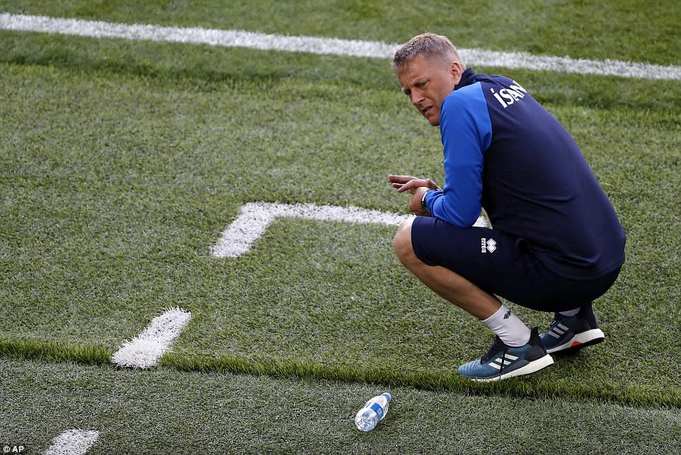 Iceland counterpart Heimir Hallgrimsson, who also works as a dentist, crouches deep in thought in the dugout