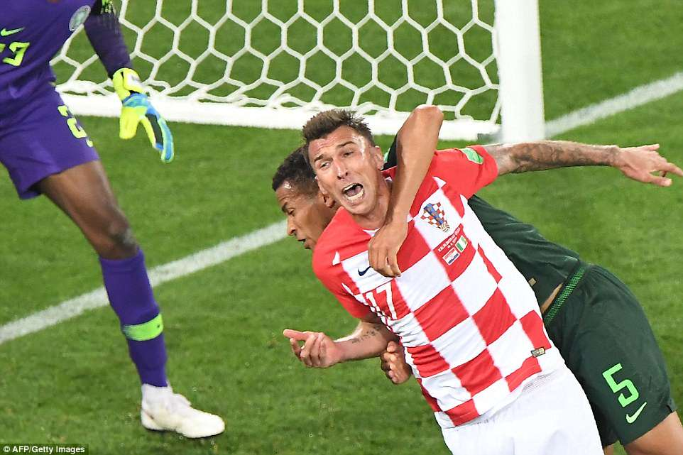 Croatia's second goal came from a penalty awarded for a foolish foul by defender William Troost-Ekong (No 5) on Mandzukic