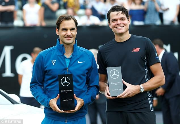 Federer was joined by his opponent Milos Raonic for the presentation ceremony