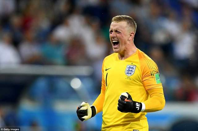 England's No 1 Jordan Pickford turns to the travelling England supporters and lets out a yell of celebration after the goal