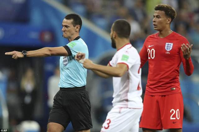Referee Wilmar Roldan points to the penalty spot to award Tunisia with a spot kick and a golden chance to level the match