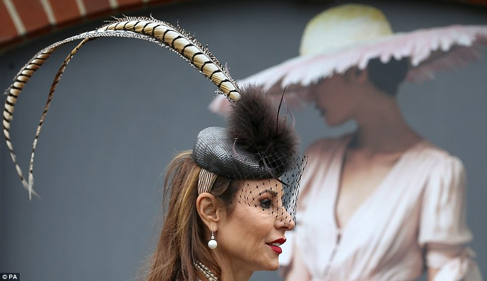 All in the details: While this woman's dress may have been nothing to write home about she more than made up for it in the hat stakes with this head-turning titfer topped off with what appeared to be a pheasant feather