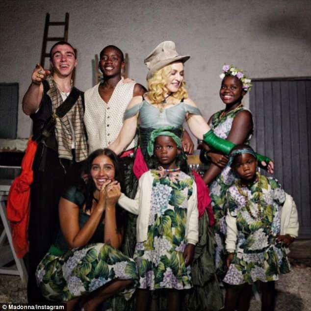 2017 family portrait:Madonna is also mother to 23-year-old daughter Lourdes (with trainer Carlos León), 20-year-old son Rocco (with ex-husband #2 Guy Ritchie), 14-year-old daughter Mercy, and eight-year-old twins Estere + Stelle