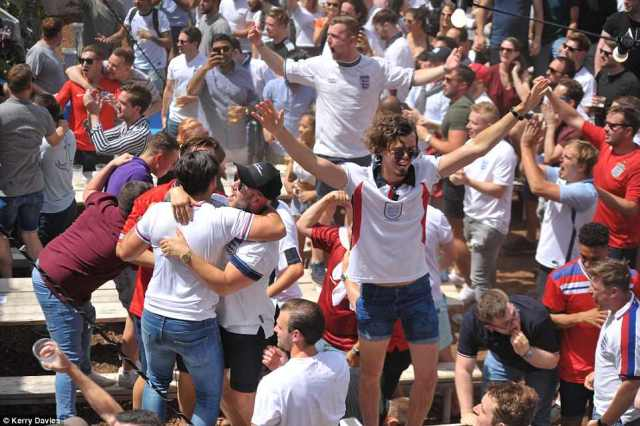 England fans at the Enchanted Gardens,  Shoreditch, London, celebrate during England's dominant performance today