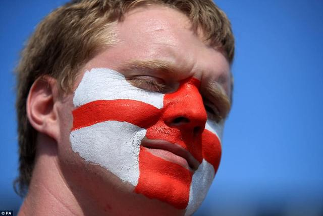 An England fan shows off his face paint with the St George's Cross as he gets ready to watch his side play Panama