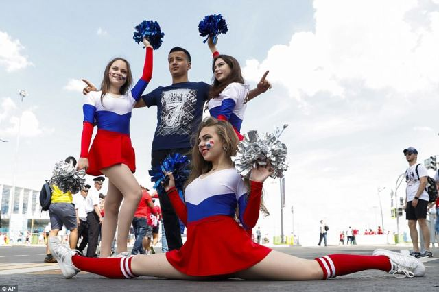 Cheerleaders pose with a fan outside the Nizhny Novgorod Stadium before the group G match between England and Panama