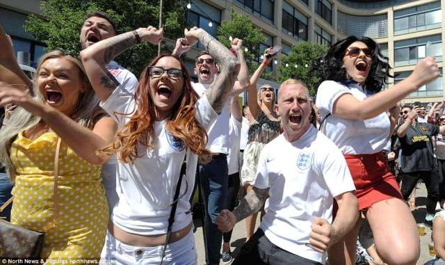 Jubilant England supporters celebrate as Harry Kane fires England 2-0 ahead as they watch the game in Newcastle
