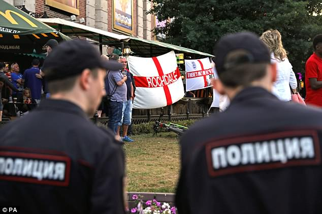 Police monitor English football fans in a bar in Kaliningrad ahead of the Belgium match