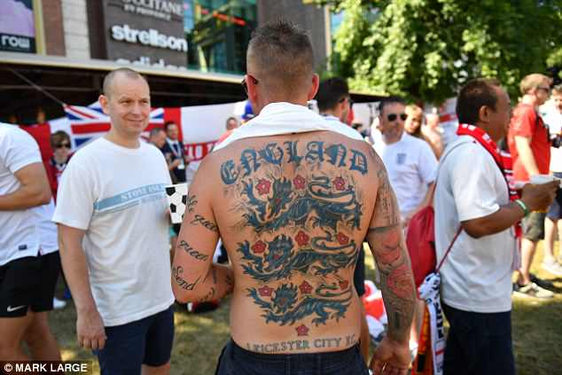 An England and Leicester City fan shows off his huge tattoo in Kaliningrad today