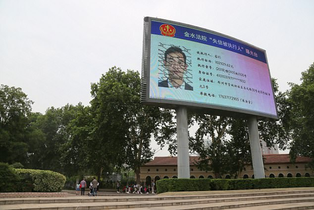 The Zhengzhou Intermediate People's Court started projecting debt defaulters' names and photographs onto a giant LED monitor at a public plaza in April