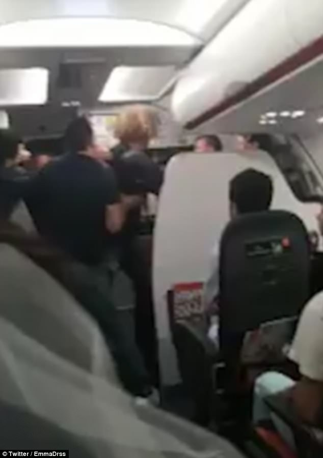 Shocking footage shows a man being held in a chokehold by security guards trying to remove him from a flight