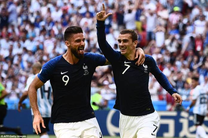 Antoine Griezmann celebrates with team-mate Olivier Giroud after scoring the opening goal of the game in Kazan