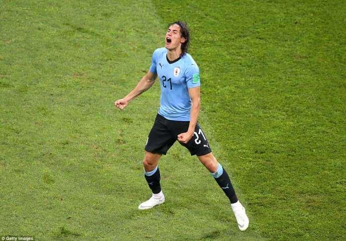 Edinson Cavani celebrates after his goal in the 7th minute put Uruguay in control against Portugal on Saturday night
