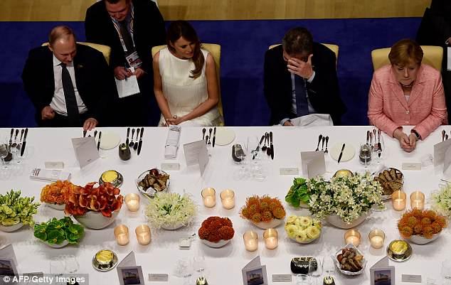 Russia's President Vladimir Putin, US First Lady Melania Trump, Argentinia's President Mauricio Macri, and German Chancellor Angela Merkel attend a G20 banquet in Hamburg last July