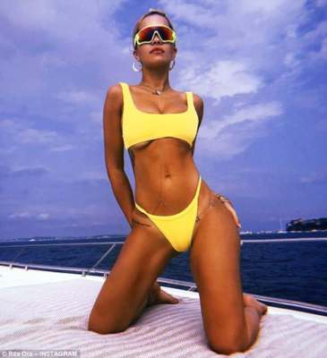 Sizzling: Rita Ora, 27, took to her Instagram platform on Tuesday to show off her perfectly honed physique in a skimpy yellow bikini as she continued her French getaway