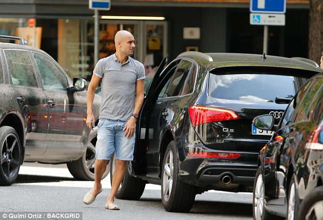 After his shopping trip, the Manchester City boss headed outside to get into his Audi 4x4