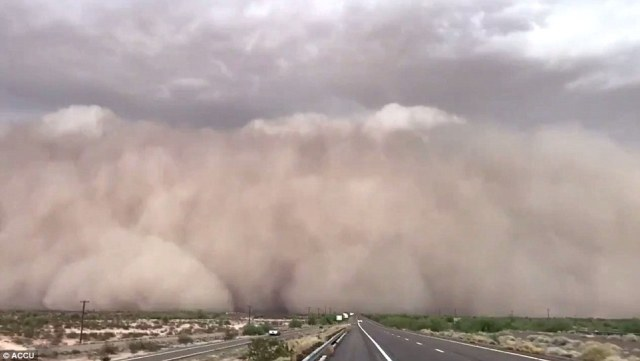 A wall of dust enveloped the Phoenix metro area, turning daylight into darkness for more than an hour Monday, as a monsoon storm rolled through