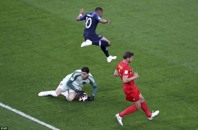 Paul Pogba put a ball through for Kylian Mbappe and the rapid striker almost latched onto it but Courtois gathered