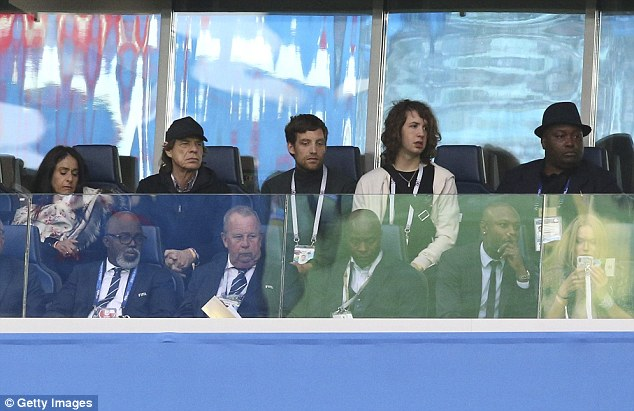 Family time: Mick Jagger, 74, used his time off to catch up with his sons, James, 32, and Lucas, 19, as they watched France and Belgium play in the World Cup semifinals in Russia on Tuesday