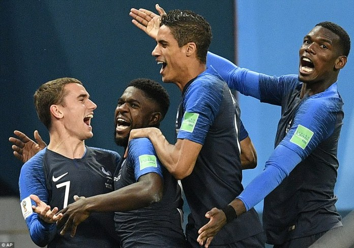 The French players celebrated with the centre-back after breaking the deadlock in a tight, tense semi-final