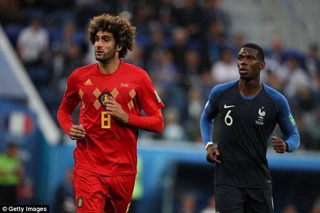 Pogba impressed opposite Manchester United club-mateMarouane Fellaini (left) in midfield