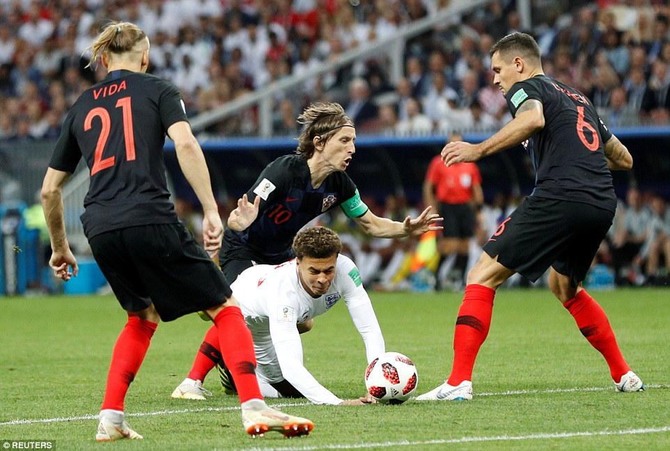 Tottenham midfielder Dele Alli falls down under the challenge from Modric leading to the free-kick for the opening goal