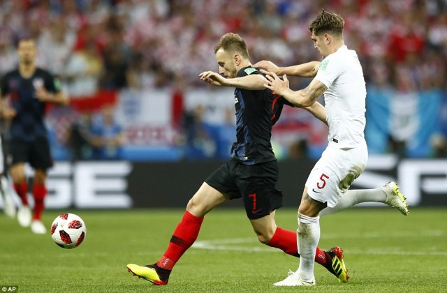 Croatia midfielder Ivan Rakitic looks to get his foot on the ball early in the game as John Stones tries to put pressure on