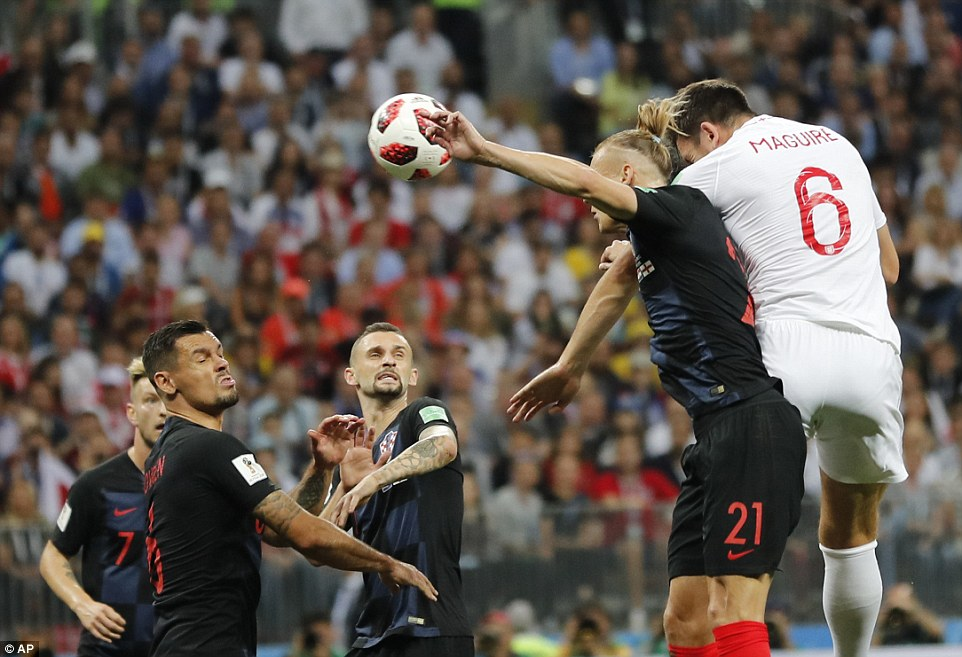 England defender Maguire leaps ahead ofCroatia centre-back Vida but cannot direct his header from a corner goalwards