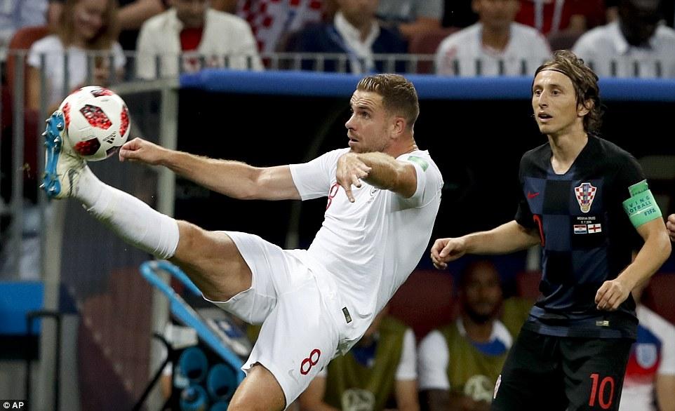 England midfielder Jordan Henderson gets his foot on the ball as Croatia captain Modric watches his midfield counterpart