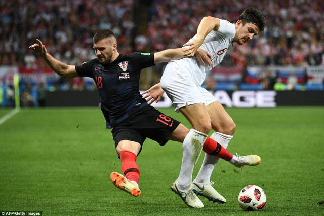 England defender Harry Maguire muscles opposite number Ante Rebic off the ball and brings it out from defence