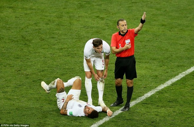 The referee calls for medical attention to be given to Kyle Walker after the ball struck him in the midriff blocking a shot on goal