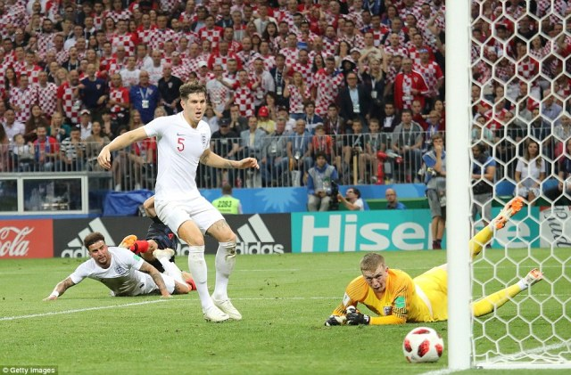Kyle Walker, John Stones and Jordan Pickford can only watch as Ivan Perisic's effort hits the foot of the post for Croatia